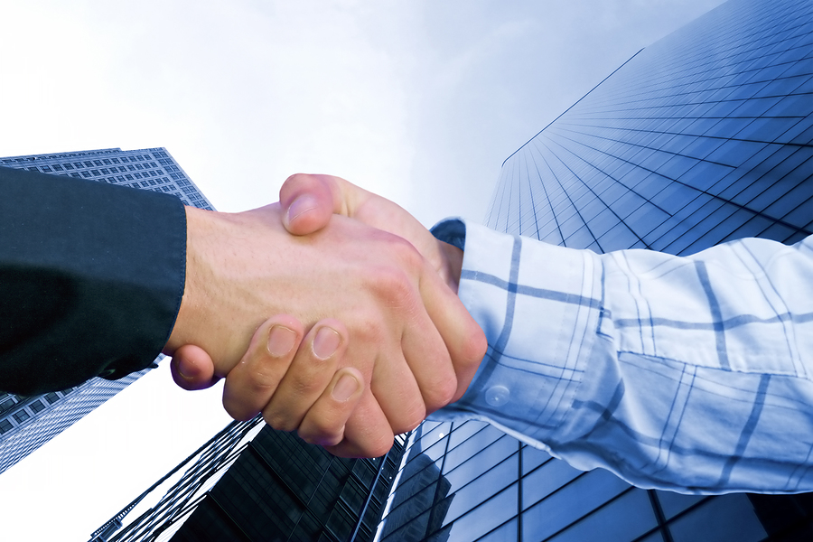 bigstockphoto Corporate Deal   Blue Handshak 104958 How do you settle debt without bankruptcy?