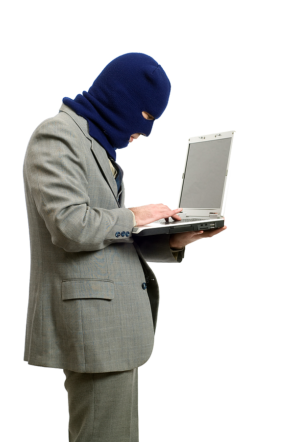 bigstock Computer Thief 4291751 Watch Out For Identity Theft Scams – 2 of the Most Dangerous Ones